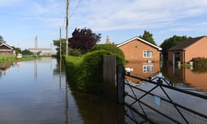 Houses surrounded by flood water on Matt Pit Lane in Wainfleet.