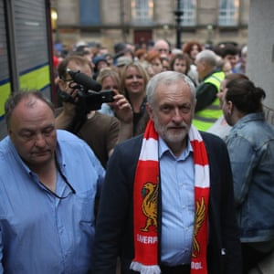 Jeremy Corbyn leaves a rally in Liverpool, attended by thousands of supporters, wearing a Liverpool FC scarf.