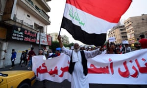 Protesters in Nasiriyah shortly after the Iraqi prime minister's resignation.