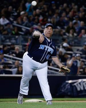 Chris Christie participates a softball game at Yankee Stadium in 2015.