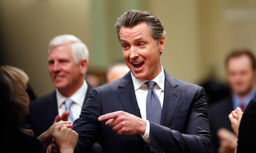 Gavin Newsom greets people on the assembly floor before delivering his first State of the State address.