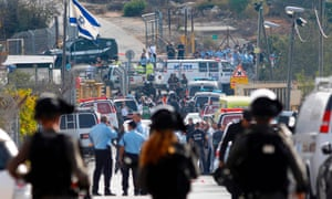 Israeli security personnel and emergency services gather at the site of the attack at the settlement of Har Adar.