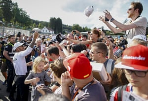 Spa-Francorchamps, Belgium Driver Lewis Hamilton signs caps and poses for selfies with fans at the Spa circuit, where the Formula One Belgian Grand Prix is taking place