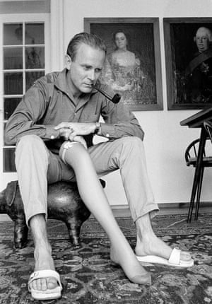 Loriot, cartoonist and satirist in his home with woman's leg, Munich, Germany, 1958