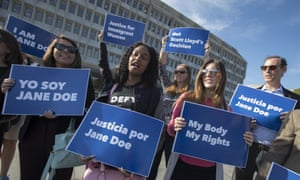 Activists with Planned Parenthood support a pregnant 17-year-old being held in a Texas facility seeking an abortion, in Washington on Friday.