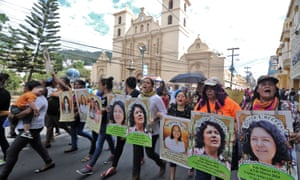 Marchers carry posters of murdered Honduran indigenous environmentalist Berta Cáceres during an International Women's day demonstration in Tegucigalpa on Tuesday.