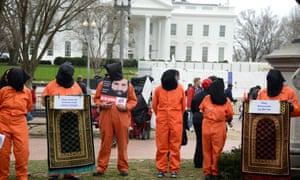 Protestors mark 18th anniversary of Guantánamo Bay detention camp and call for its closure and 'accountability for torture' near the White House, on 11 January.