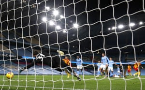 Manchester City's Ederson dives but is beaten by the deflection off Dias.