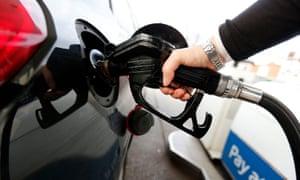 Diesel fuel being pumped into car