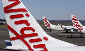 Virgin Australia planes are parked at terminal at Sydney Airport
