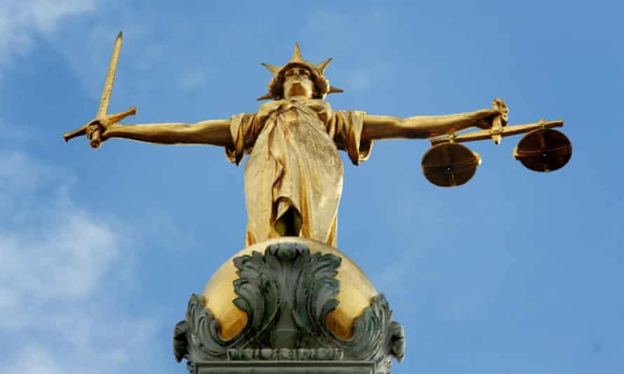 Lady Justice, holding scales and a sword, on top of the Old Bailey in central London