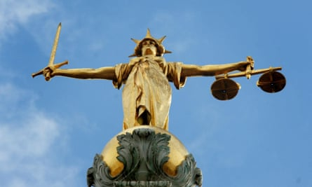 Lady Justice, holding scales and a sword, on top of the Central Criminal Court