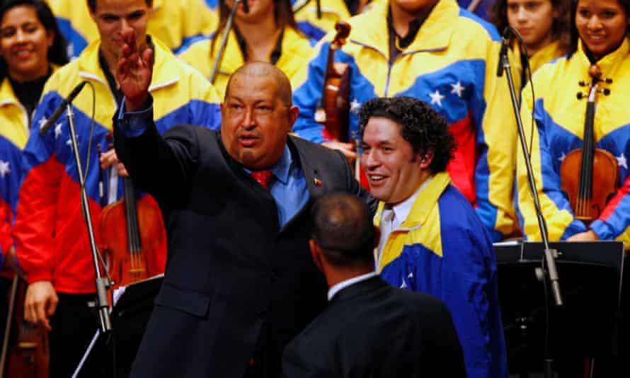Hugo Chávez with Gustavo Dudamel after a concert with the Símon Bolívar Symphony Orchestra in 2011. Photograph: AP