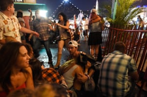 People run for cover at the Route 91 Harvest country music festival after apparent gun fire was heard