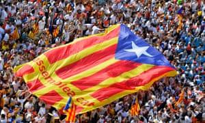 Catalans unfurl a huge pro-independence flag