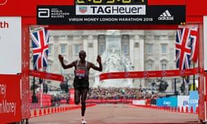 Kenya's Eliud Kipchoge celebrates winning the men's race.