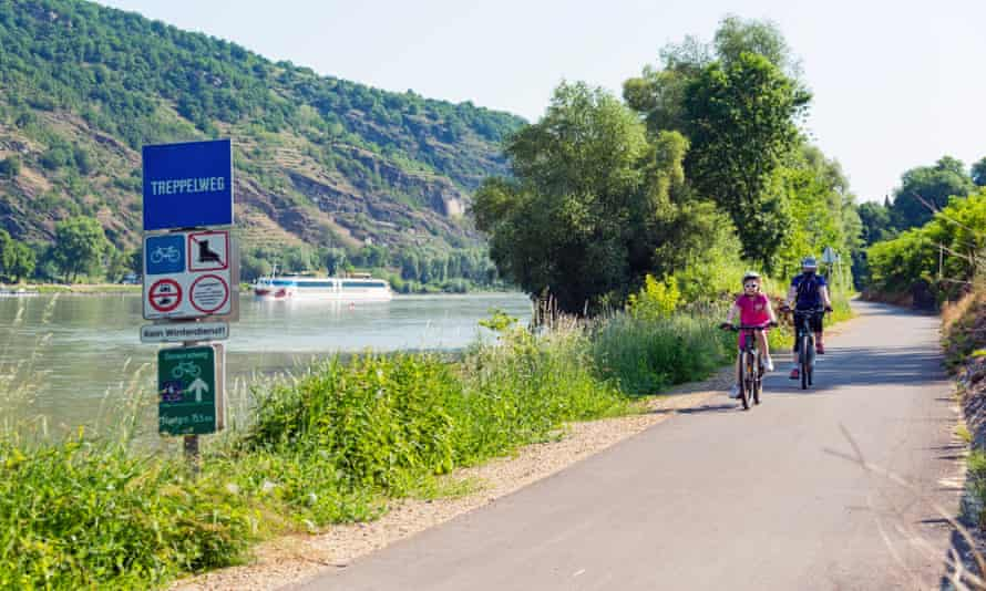 Mother and daughter cycling along Danube river in Wachau Valley, Austria