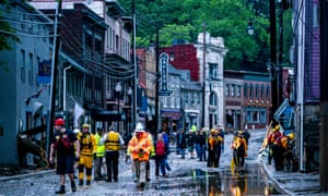 Rescue personnel examine damage on Main Street after a flash flood rushed through the historic town of Ellicott City, Maryland on 27 May 2018.