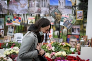 A woman cries at a makeshift memorial for Armenians killed during the military conflict with Azerbaijan over the breakaway region of Nagorno-Karabakh outside the Armenian embassy in Moscow.