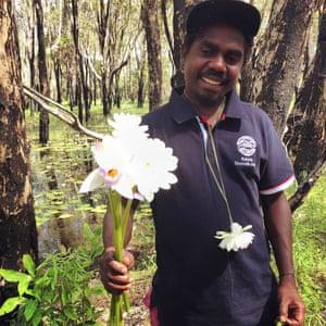 Selone Djandjomerr offers a floral tribute at a billabong just outside Jabiru