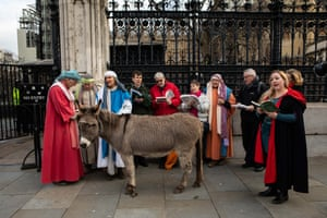 London, UKMembers of the Wintershall Nativity group outside of Parliament with their donkey Chester singing christmas carols the day after the election