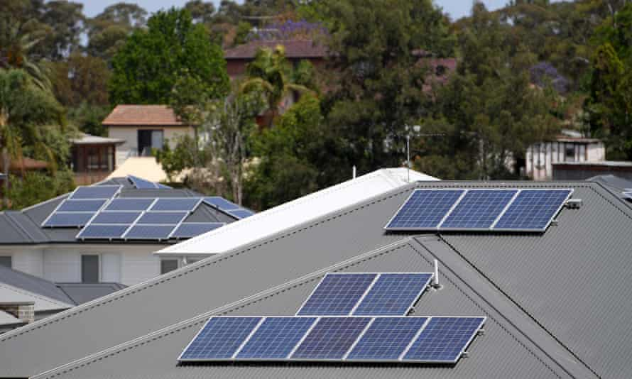 Solar panels are seen on the rooftops of houses in north-west Sydney.