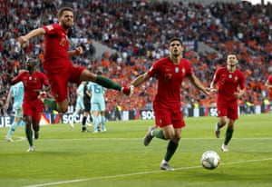 Portugal's Gonçalo Guedes, second right, after scoring.