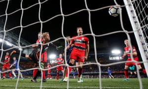 The Huddersfield players hold their breath as Jonas Lössl's fingertip save comes back off the post to deny Chelsea a winner after a wild goalmouth scramble.