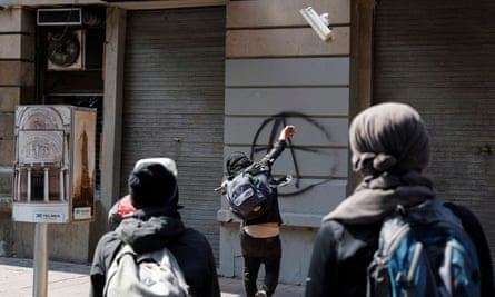 A demonstrator in Mexico City vandalises a surveillance camera during a march against the police violence days after riot police officers kicked a protester in the head while demonstrating against the deaths of George Floyd in the U.S. and Giovanni Lopez in Mexico.