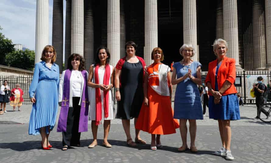 Anne Soupa with members of the collective Toutes Apôtres! in front of La Madeleine church in Paris