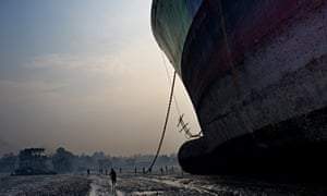 A huge freighter towers over a beach in Chittagong, where it will be disassembled and its parts recycled