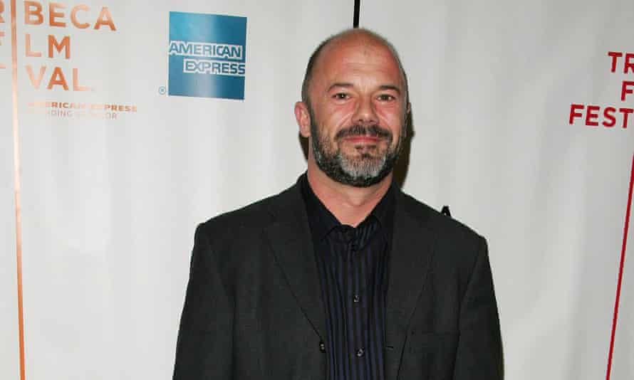 Andrew Sullivan on the red carpet at an awards ceremony.
