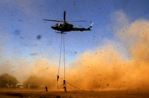 Makassar, Indonesia Soldiers descend from a helicopter during a counter-terrorism drill.