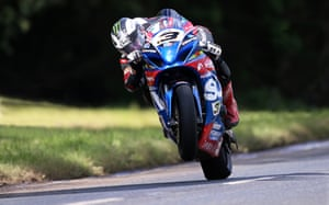 Michael Dunlop wheelies on his way to victory at the Armoy road races.