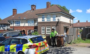 Police officers at the property in Shiregreen, Sheffield.