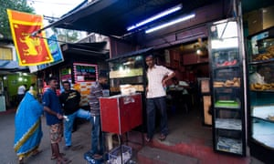A small hole in the wall restaurant serving appams and kottu roti in Kandy, Sri Lanka