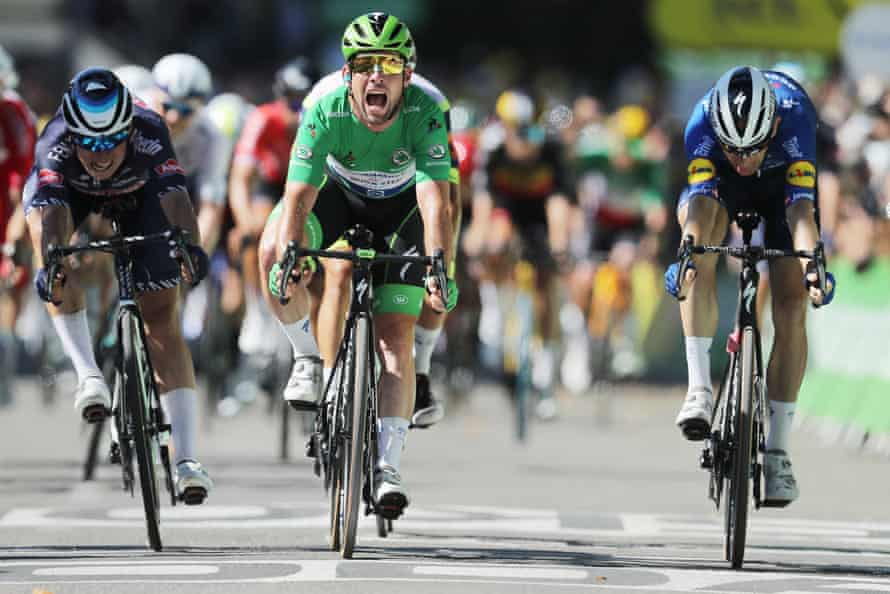 Mark Cavendish of the Deceuninck Quick-Step team celebrates as he crosses the finish line to win the 13th stage of the Tour de Frances