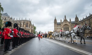 The Queen's procession arrives at the Palace of Westminster for the state opening of parliament.