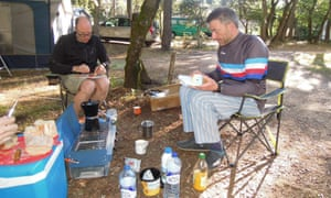 Another croissant?: Mark and Frank get the carbs in at the campsite at Bédoin, at the foot of Mont Ventoux