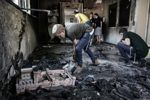 Scouring a burned-out synagogue