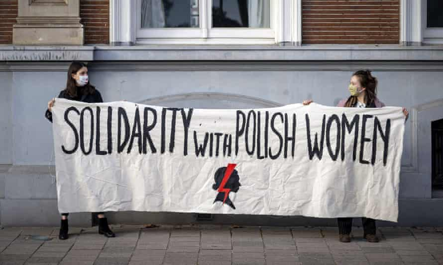 Dutch women show their support outside the Polish embassy in The Hague