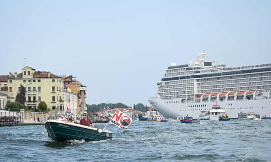 Activists in Venice protesting against cruise ships as the MSC Orchestra left the city from the Giudecca Canal earlier this month.