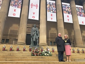 The mayor of Liverpool, Joe Anderson, and lord mayor Christine Banks stand on the steps of St George's Hall.