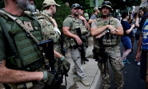 Members of a militia stand near a rally in Charlottesville, Virginia, this past weekend.