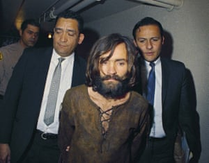 Cult leader Charles Manson is escorted to his arraignment on conspiracy-murder charges in connection with the Sharon Tate murder case in 1969.