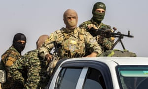 Fighters from the Syrian Democratic Forces as they withdraw from the Sanjak Saadoun border area near the northern Syrian town of Amuda, on 27 October.