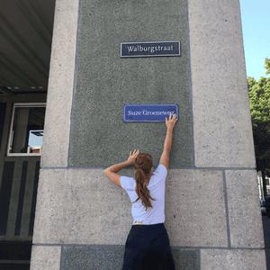 Activists install a sign celebrating Suze Groeneweg, a Dutch politician.