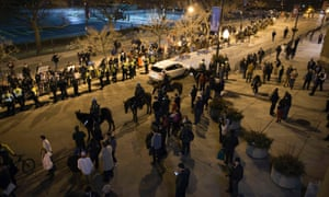 Chicago police block streets outside the rally
