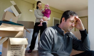 Family moving into home looking stressed