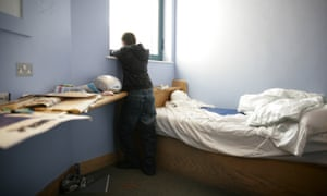 A boy in his room in a secure children's home for young offenders in south London